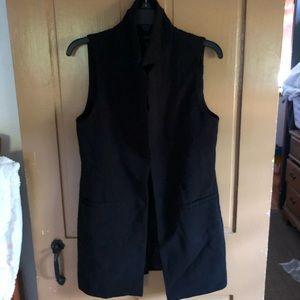 Women's long black vest.  Fully lined.
